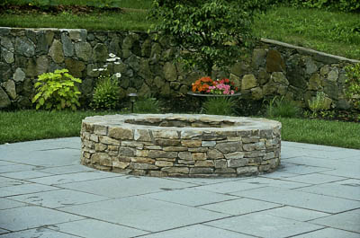 round fire pit on blue stone